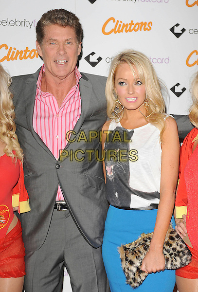 David Hasselhoff and Hayley Roberts.'Clintons launch of the Celebrity Fastcard' No.5 Cavendish Square, London, England..18th October 2011.half length grey gray suit pink shirt striped stripes white sleeveless top fur furry leopard print clutch bag blue skirt puma cat print animal couple.CAP/BEL.©Tom Belcher/Capital Pictures.