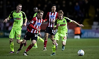 Bolton Wanderers' Ronan Darcy (right) competing with Lincoln City's Jake Hesketh (centre)  <br /> <br /> Photographer Andrew Kearns/CameraSport<br /> <br /> The EFL Sky Bet League One - Lincoln City v Bolton Wanderers - Tuesday 14th January 2020  - LNER Stadium - Lincoln<br /> <br /> World Copyright © 2020 CameraSport. All rights reserved. 43 Linden Ave. Countesthorpe. Leicester. England. LE8 5PG - Tel: +44 (0) 116 277 4147 - admin@camerasport.com - www.camerasport.com