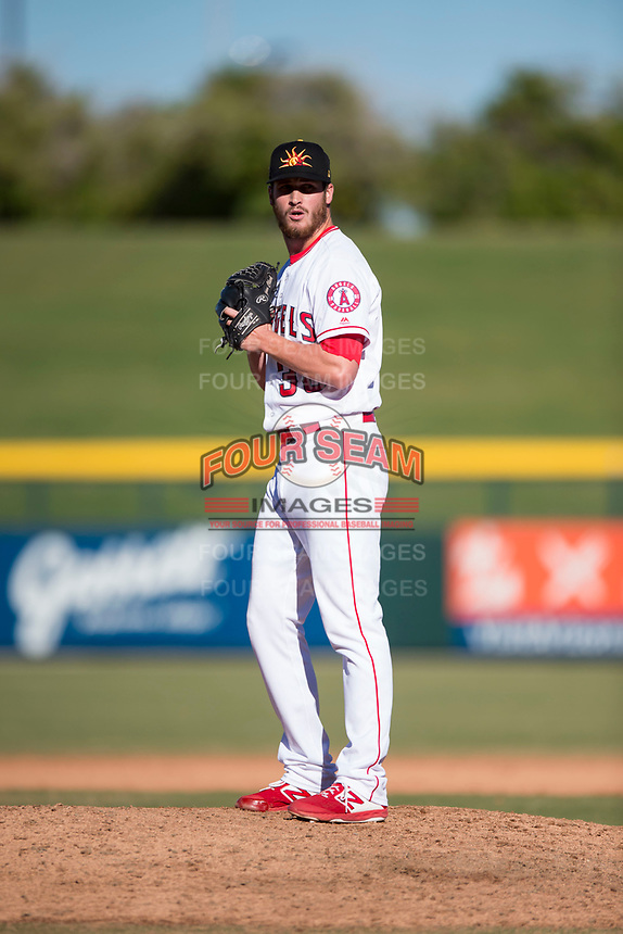 Mesa Solar Sox relief pitcher Ryan Clark (38), of the Los Angeles Angels organization, gets ready to deliver a pitch during an Arizona Fall League game against the Peoria Javelinas at Sloan Park on November 6, 2018 in Mesa, Arizona. Mesa defeated Peoria 7-5 . (Zachary Lucy/Four Seam Images)