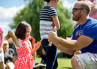 NWA Democrat-Gazette/JASON IVESTER <br /> Ramona McIver (cq), 5, of Fayetteville swings her hand toward a breaking board held by Rich Fordham with Pro Martial Arts on Wednesday, Aug. 12, 2015, during the Macaroni Kid Back to School Party at Village on the Creeks in Rogers. Children were treated to snacks, crafts and martial arts demonstrations at the free event.