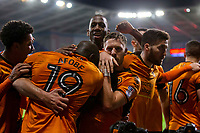 Ruben Neves of Wolverhampton Wanderers (obscured) is mobbed after scoring his side's first goal during the Sky Bet Championship match between Cardiff City and Wolverhampton Wanderers at the Cardiff City Stadium, Cardiff, Wales on 6 April 2018. Photo by Mark  Hawkins / PRiME Media Images.