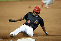 Batavia Muckdogs center fielder Brayan Hernandez (18) slides into third on a triple during a game against the Lowell Spinners on July 14, 2018 at Dwyer Stadium in Batavia, New York.  Lowell defeated Batavia 8-4.  (Mike Janes/Four Seam Images)