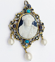 BNPS.co.uk (01202 558833)<br /> Pic: KidsonTrigg/BNPS<br /> <br /> £3000 - C18th reversable pendant, central shell cameo in a pierced yellow metal mount set with turquoise & drop pearls with enamel decoration verso. <br /> <br /> Frozen Assets - Over a £100,000 of Renaissance era jewellry found under a frozen joint of lamb in a run down chalet bungalow is coming up for auction.<br /> <br /> Amazed auctioneers found the hidden gems in the ramshakle hoarders freezer near Uffington in Wiltshire - where the canny late owner had gone to great lengths to protect her precious haul.<br /> <br /> However, the hidden stash wasn't the result of a bank heist but belonged to an eccentric collector who amassed the items in the 1960s - and kept the receipts to prove it.<br /> <br /> She passed away recently and her family brought in experts to hunt out relics they knew their relative had hidden away over the years.
