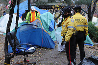 November 23, 2011, Toronto Police arrived in significant numbers this morning, beginning the process of evicting the Occupy Toronto tent camp from St. James Park.  Here Police watch as city workers dismantle and remove tents.