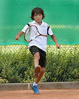 3-8-09, Asten,NJK, Kayne Trustfull laat zijn racket vliegen.