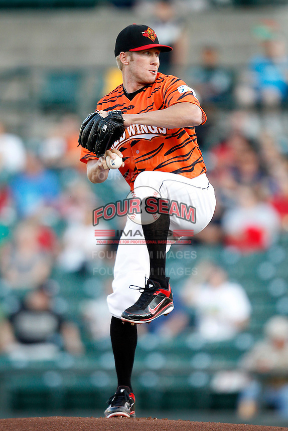 Rochester Red Wings pitcher Cole DeVries #21 delivers a pitch during a game against the Pawtucket Red Sox at Frontier Field on August 30, 2011 in Rochester, New York.  Rochester defeated Pawtucket 8-6 as the team wore special jerseys to be auctioned off after the game to benefit the zoo.  (Mike Janes/Four Seam Images)