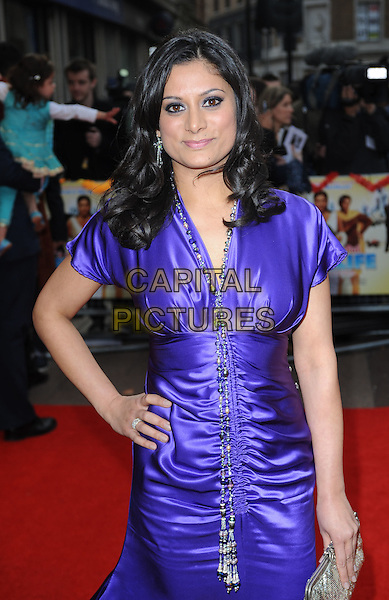 """GOLDY NOTAY.The UK Premiere of """"It's A Wonderful Afterlife"""", Odeon West End, London, England..12th April 2010.half length purple silk satin ruched dress hand on hip silver necklace clutch bag .CAP/BEL.©Tom Belcher/Capital Pictures."""