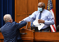 Dr. Anthony Fauci (L), director of the National Institute for Allergy and Infectious Diseases, fist bumps Committee Chairman United States House Assistant Democratic Leader James Clyburn (Democrat of South Carolina), before testifying in front of the House Subcommittee on the Coronavirus Crisis during a hearing on a national plan to contain the COVID-19 pandemic, on Capitol Hill in Washington, DC on Friday, July 31, 2020. <br /> Credit: Kevin Dietsch / Pool via CNP /MediaPunch