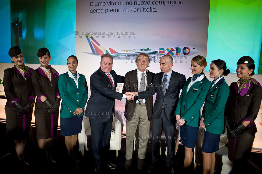 Rome, January 20 ,2015. Il Vice Presidente e Ceo del gruppo Etihad e Vice Presidente Alitalia posa con Luca Cordero di Montezemolo e Silvano Cassano al termine della conferenza stampa per la presentazione della nuova partnership tra Aliatalia e Gruppo Etihad. James Hogan,James Hogan (L) President and CEO of Etihad Aviation Group and Vice President of Alitalia, poses with Italian Luca Cordero di Montezemolo, President of Alitalia (C) and Italian Silvano Cassano CEO of Alitalia, attend the press conference topromote the new Alitalia service.