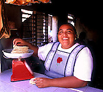 Ma Esther selling tortillas in her tortilleria on Isla de Holbox, Mexico.