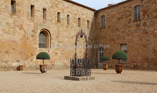 18th century courtyard at Fontfroide Abbey or l'Abbaye Sainte-Marie de Fontfroide, Narbonne, Languedoc-Roussillon, France. Founded by the Viscount of Narbonne in 1093, Fontfroide linked to the Cistercian order in 1145. This courtyard is sometimes wrongly named 'Louis XIV', but the building work began in 1775. The courtyard is centred around wells which drop to cold water sources in the chalk beds, hence the name 'Fontfroide'. Picture by Manuel Cohen