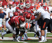 NWA Democrat-Gazette/ANDY SHUPE<br /> Arkansas' Brooks Ellis (left) and Bijhon Jackson (center) tackle University of Texas at El Paso's Jeremiah Laufasa (bottom) Saturday, Sept. 5, 2015, during the third quarter of play in Razorback Stadium in Fayetteville. Visit nwadg.com/photos to see more from the game.