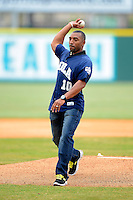 New Orleans Zephyrs guest, New Orleans Saints team ambassador and former wide receiver Michael Lewis, throws out the first pitch before a game against the Round Rock Express on April 15, 2013 at Zephyr Field in New Orleans, Louisiana.  New Orleans defeated Round Rock 3-2.  (Mike Janes/Four Seam Images)