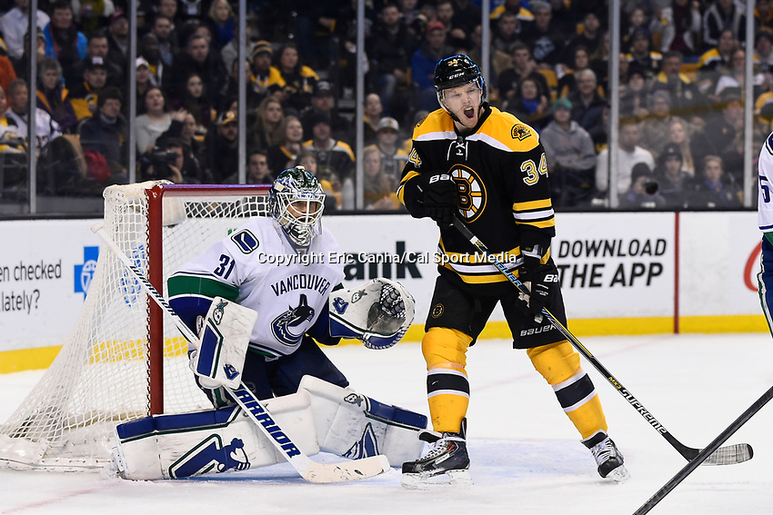 February 24, 2015 - Boston, Massachusetts, U.S. - Vancouver Canucks goalie Eddie Lack (31) and Boston Bruins center Carl Soderberg (34) in game action during the third period of the NHL match between the Vancouver Canucks and the Boston Bruins held at TD Garden in Boston Massachusetts. The Canucks defeated the Bruins 2-1 in regulation time. Eric Canha/CSM