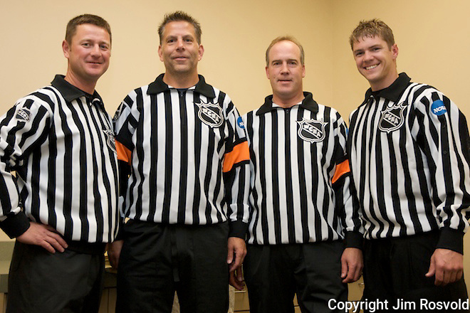 WCHA Referees pose for a pregame portrait before the game.