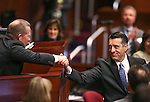 Lt. Gov. Mark Hutchison, left, shakes hands with Gov. Brian Sandoval following his State of the State address at the Legislative Building in Carson City, Nev., on Thursday night, Jan. 15, 2015. (Las Vegas Review-Journal/Cathleen Allison)