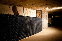 Vintage wine in underground cave at Chateau Beau-Sejour Becot at St Emilion in the Bordeaux wine region of France