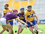 Tony Kelly of Clare in action against Paudie Foley and Kevin Foley of Wexford during their All-Ireland quarter final at Pairc Ui Chaoimh. Photograph by John Kelly.