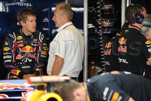 12.11.2011  Abu Dhabi, United Arab Emirates.  Yas Marina Circuit RedBull Renault German Driver Sebastian Vettel in Garage with Director Helmut Marko Formula 1 Grand Prix of Abu Dhabi, UAE.