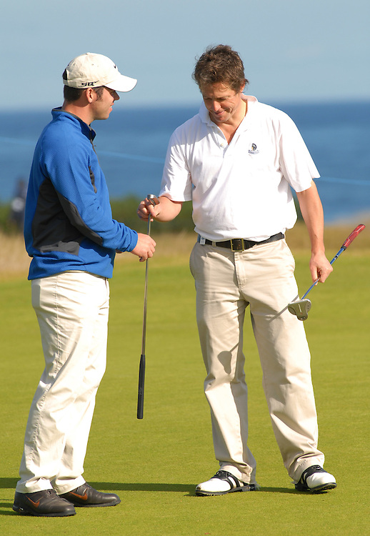 ALFRED DUNHILL LINKS CHAMPIONSHIP, ST.ANDREWS, 4-10-06..HUGH GRANT AND PAUL CASEY DISCUSS PUTTING BEFORE PRACTICING AT KINGSBARNS.PIC BY IAN MCILGORM