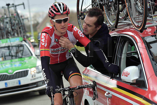 27.03.2016. Deinze, Belgium.  BENOOT Tiesj (BEL) Rider of LOTTO SOUDAL has problems with his radio during the Flanders Classics UCI World Tour 78nd Gent-Wevelgem cycling race with start in Deinze and finish in Wevelgem