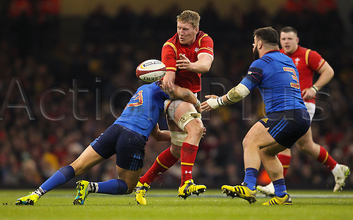 26.02.2016. Principality Stadium, Cardiff, Wales. RBS Six Nations Championships. Wales versus France. Wales Bradley Davies offloads the ball as he gets tackled by France's Maxime Mermoz