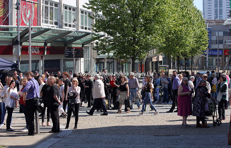 Pictured: A crowd at the junction of Union and Oxford Street in Swansea city centre with the entrance to the Quadrant in the background Wednesday 24 May 2017<br />