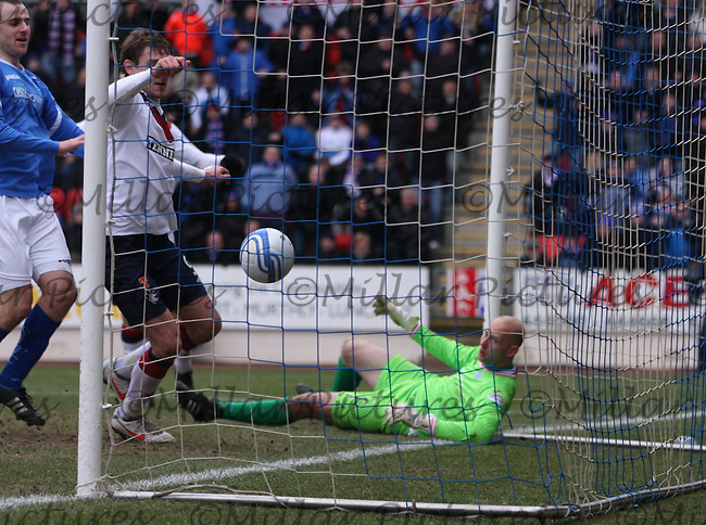 Nikica Jelavic knocks the ball into the net for the winner in the St Johnstone v Rangers Clydesdale Bank Scottish Premier League match played at McDiarmid Park, Perth on 14.1.12.