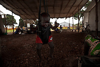 A child being weighed at the health center in Nyori Refugee camp, South Sudan..Inside this camp MSF has set up a health facility with inpatient capacity and a pharmacy. This facility provides an average of 500 consultations a week, antenatal care, deliveries and treatment for malnutrition.