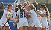 Long Beach varsity girls lacrosse teammates celebrate after their 9-8 overtime win over North Shore in the Nassau County Class B quarterfinals at Long Beach High School on Thursday, May 19, 2016.