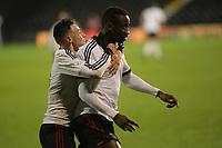 Moussa Dembele scores and celebrates his third Fulham goal