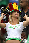 21 June 2006:  A Mexico fan tries on the colors of Portugal.  Portugal defeated Mexico 2-1 at Veltins Arena in Gelsenkirchen, Germany in match 31, a Group D first round game, of the 2006 FIFA World Cup.