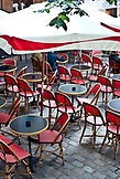 FRANCE, Paris Three people are sitting on red bistro chairs in Montmartre, Paris