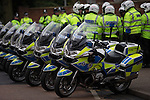 © Joel Goodman - 07973 332324 .  07/02/2015 . Dudley , UK . Police traffic motorcycles at the demonstration . Approximately 500 EDL supporters march through Dudley town centre at an English Defence League demonstration in Dudley , in the West Midlands , this afternoon ( Saturday 7th February 2015 ). They oppose the building of a new mosque in Dudley . Photo credit : Joel Goodman