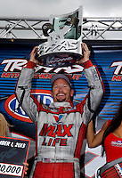Sept. 1, 2013; Clermont, IN, USA: NHRA funny car driver Jack Beckman celebrates after winning the Traxxas Shootout during qualifying for the US Nationals at Lucas Oil Raceway. Mandatory Credit: Mark J. Rebilas-