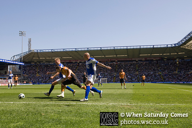 Birmingham City 1 Wolverhampton Wanderers 1, 01/05/2011. St Andrews, Premier League. Visiting winger Matt Jarvis is sandwiched between Seb Larsson (left) and Stephen Carr at St. Andrew's stadium, during Birmingham City's Barclay's Premier League match with Wolverhampton Wanderers. Both clubs were battling against relegation from  England's top division. The match ended in a 1-1 draw, watched by a crowd of 26,027. Photo by Colin McPherson.