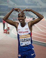 Mo Farah of GBR (Men's 3000m) does his trademark M during the Sainsburys Anniversary Games Athletics Event at the Olympic Park, London, England on 24 July 2015. Photo by Andy Rowland.
