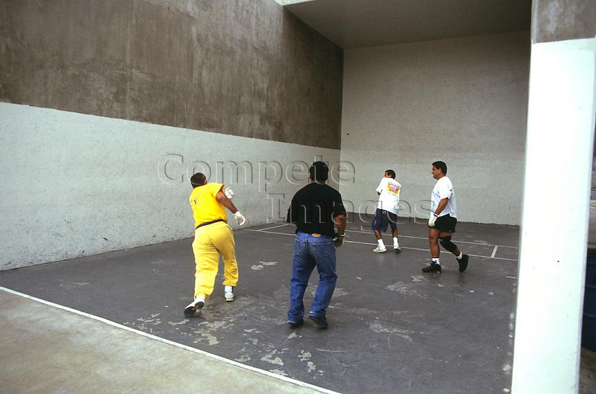 Four men playing handball