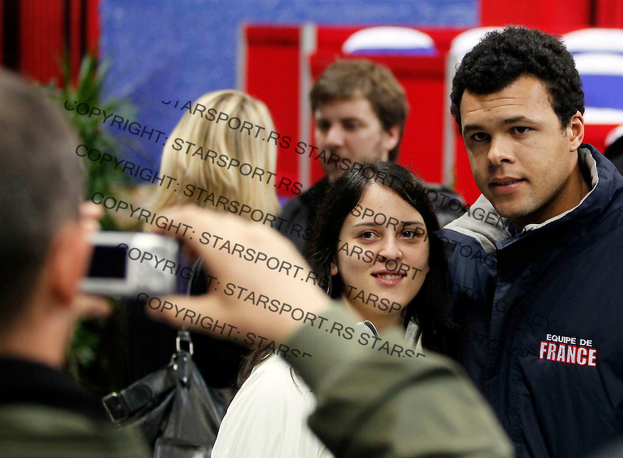 French Davis Cup  player, Jo-Wilfred Conga, pose with fan, during French team practice session. France will play against Serbia for the Davis Cup final on December 3-5.  in Belgrade, Serbia, Thursday, 2. December 2010. (photo: Srdjan Stevanovic/Starsportphoto.com