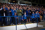 Home supporters in the grandstand welcoming their team on to the pitch before Coleraine played Spartak Subotica of Serbia in a Europa League Qualifying First Round second leg at the Showgrounds, Coleraine. The hosts from Northern Ireland had drawn the away leg 1-1 the previous week, however, the visitors won the return leg 2-0 to progress to face Sparta Prague in the next round, watched by a sell-out crowd of 1700.