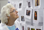 Phylis Newton of Indiana surveys photos and descriptions on a timeline of Methodist women leaders at the United Methodist Women Assembly in the Kentucky International Convention Center in Louisville, Kentucky, on April 25, 2014.