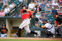 Indianapolis Indians catcher Tony Sanchez #19 doubles in front of catcher Francisco Cervelli and umpire Jeff Gosney during a game against the Empire State Yankees at Frontier Field on August 4, 2012 in Rochester, New York.  Empire State defeated Indianapolis 9-8 in ten innings.  (Mike Janes/Four Seam Images)
