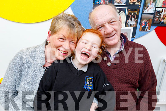 Aoibheann Joy with her grandparents Kay and Brendan Kerins at the Grandparents Day in  Scoil Nuachabháil on Friday.
