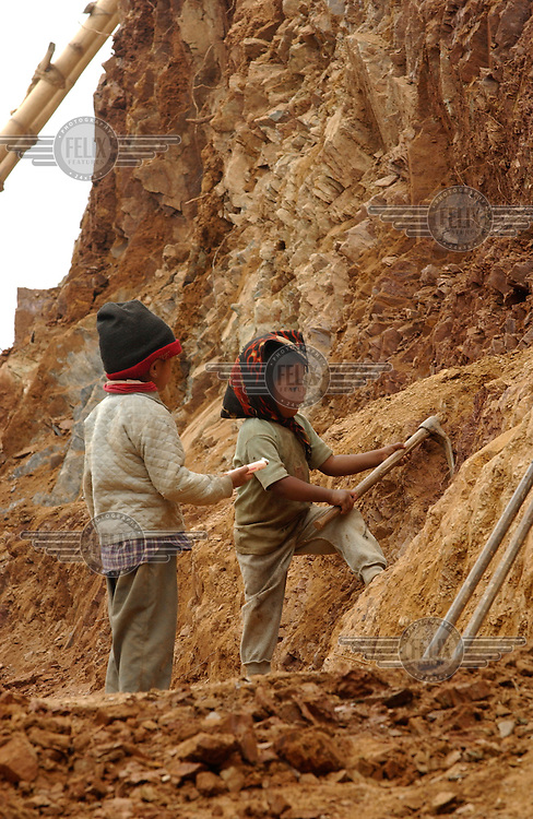 Children work constructing the road from Rolpa to Thabang. Nearly every citizen living in the Maoist stronghold of Rolpa is conscribed for 15 days at a time to work on the road between Rolpa and Thabang; a project which the central government had promised but never delivered.
