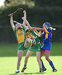 Aoife Keane and Teresa O Keeffe of Inagh-Kilnamona in action against Sharon Mc Mahon of Newmarket during their senior county final in Clarecastle. Photograph by John Kelly.