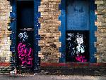 Derelict door and window with graffiti