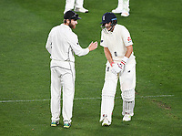 New Zealand captain Kane Williamson checks captain Joe Root after Root injured his finger.<br /> New Zealand Blackcaps v England. 1st day/night test match. Eden Park, Auckland, New Zealand. Day 4, Sunday 25 March 2018. &copy; Copyright Photo: Andrew Cornaga / www.Photosport.nz