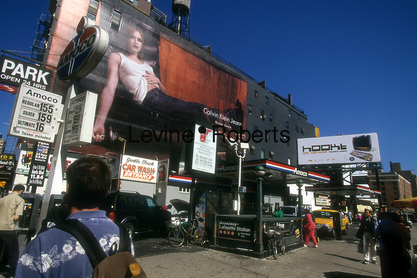 A Calvin Klein Jeans billboard on a busy, confusing corner in the Soho neighborhood of New York on September 18, 1999.  Klein's advertisements use sex and provocative images to test society's cultural and moral boundries. (© Richard B. Levine)