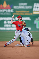 Mississippi Braves second baseman Alejandro Salazar (48) throws to first base as Jeffrey Baez (33) slides in during a Southern League game against the Jackson Generals on July 23, 2019 at The Ballpark at Jackson in Jackson, Tennessee.  Jackson defeated Mississippi 2-0 in the first game of a doubleheader.  (Mike Janes/Four Seam Images)