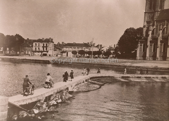 Photograph of the concrete dam built to allow passage from one bank to the other after the destruction of the Grand-Rue bridge at Sable-sur-Sarthe, Pays de la Loire, France, in a bombing raid on 7th August 1944 by the German Luftwaffe, during the Second World War. The bridge was bombed in order to slow down the advance of the Allies into the town. Collection G Cherrier. Picture by Manuel Cohen / Further clearances required
